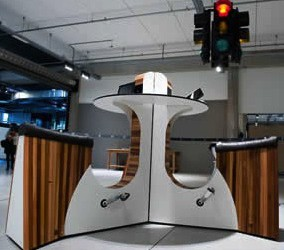 These Cycling Desks Charge Your Phone–And Your Muscles–While You Work